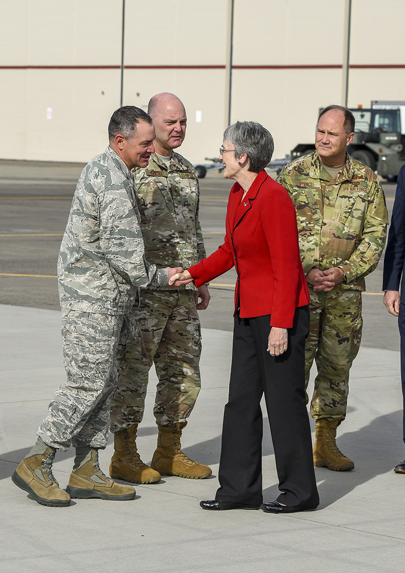Secretary of the Air Force, Heather Wilson, arrives at the 173rd Fighter Wing and is greeted by wing commander (from left), Col. Jeff Smith, Oregon Air National Guard Commander, Brig. Gen. James Kriesel, and the Oregon Adjutant General, Maj. Gen. Mike Stencel, Nov. 3, 2018. The secretary's visit provides her a first-hand look at the wing's mission as the sole provider of F-15C air superiority pilots to the U.S. Air Force. (U.S. Air National Guard photo by Staff Sgt. Riley Johnson)