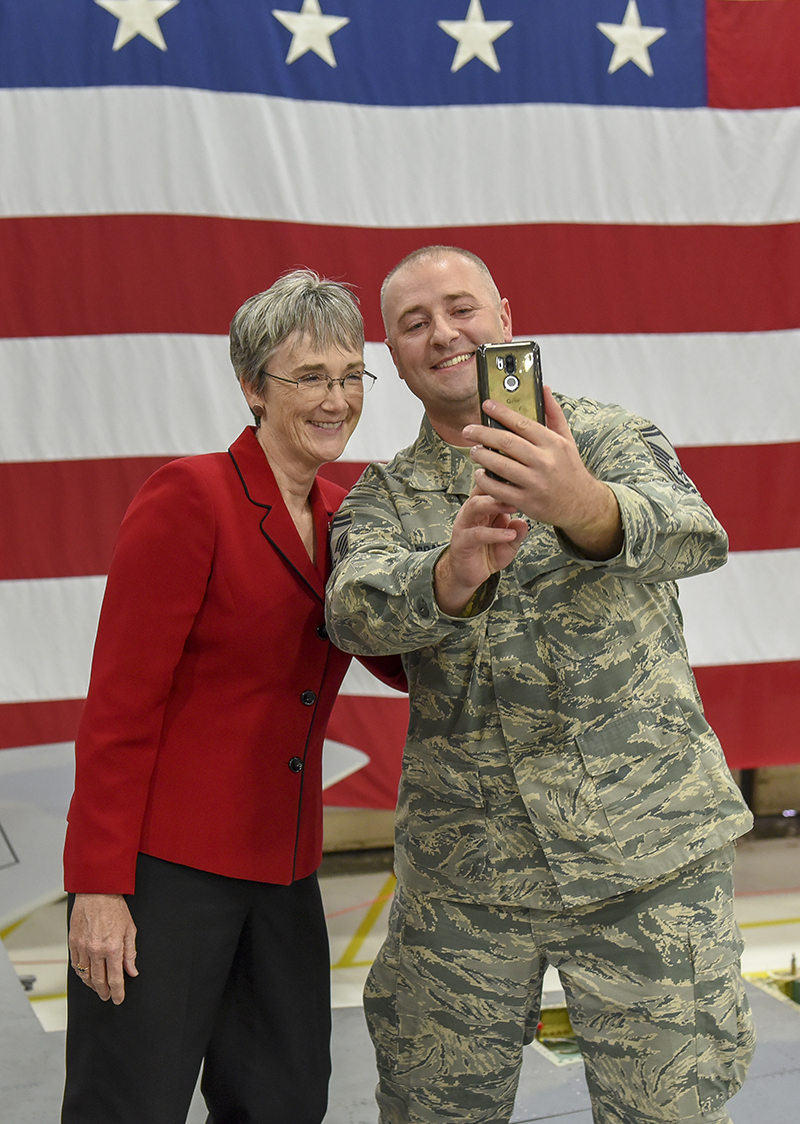 U.S. Air Force Senior Master Sgt. Collin Grandy takes a selfie with Secretary of the Air Force, Heather Wilson, after she coined him, Nov. 3, 2018. The Secretary's visit provides her a first-hand look at the wing's mission and the Airmen who make it happen. (U.S. Air National Guard photo by Staff Sgt. Riley Johnson)