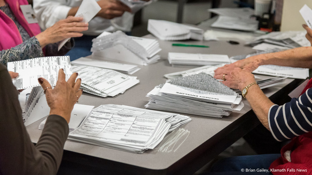 Volunteers at the Klamath County Clerks Office prepare ballots to be counted. November 6, 2018 (Brian Gailey)