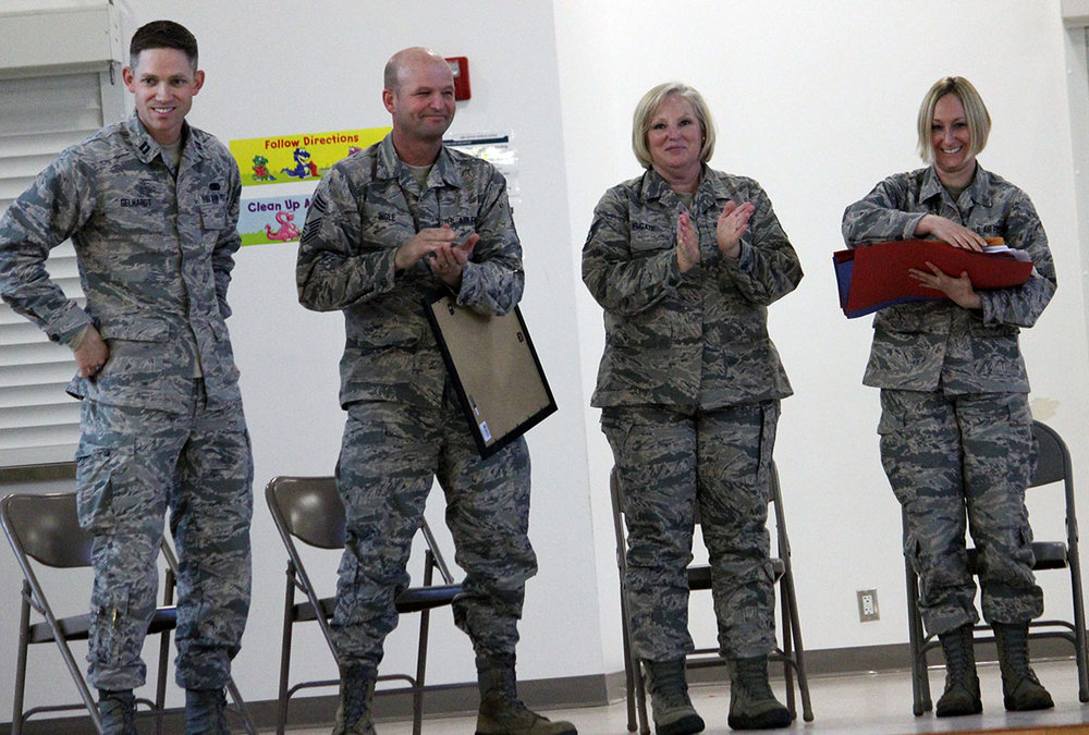 Captain Scott Gelhardt, Chief Master Sgt. Dominic Ingle, Tech Sgt. Sandra Fugate and Master Sgt. Bobbi Uhlig of the 173rd Fighter Wing at Kingsley Field accept thank you cards from students at Peterson Elementary School.
