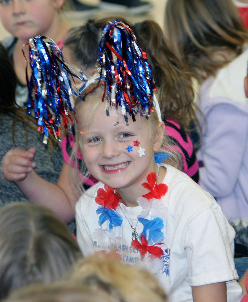 Brynlee Nelson, a first-grader at Peterson Elementary School, was among students and staff who donated at least $5 to wear red, white, and blue, raising money for the David R. Kingsley Foundation, which helps local military families in need.