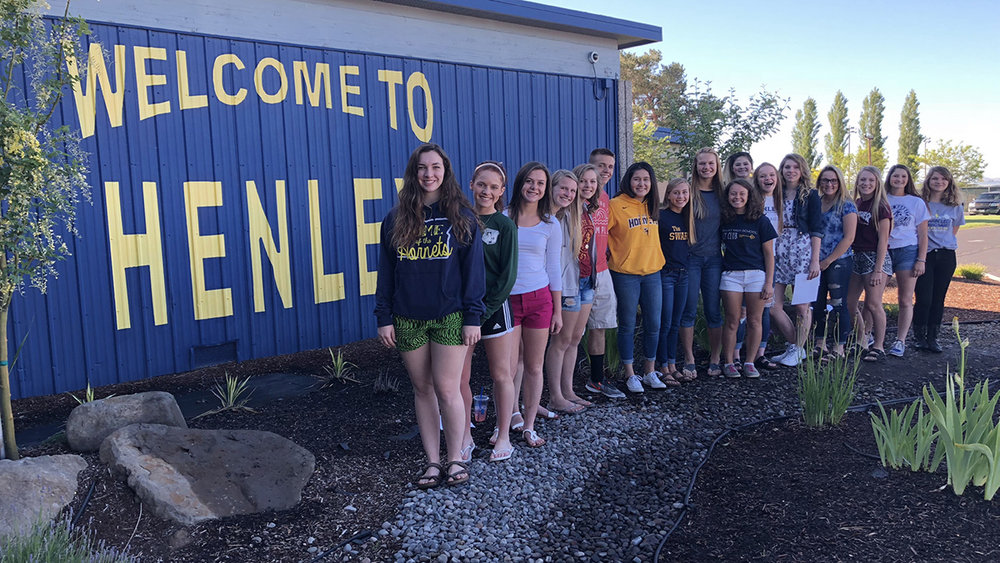 Henley students volunteer to help with the Hunger: Not Impossible program. Overall, 24 students Henley and Mazama volunteered over 558 of their summer hours to the project.
