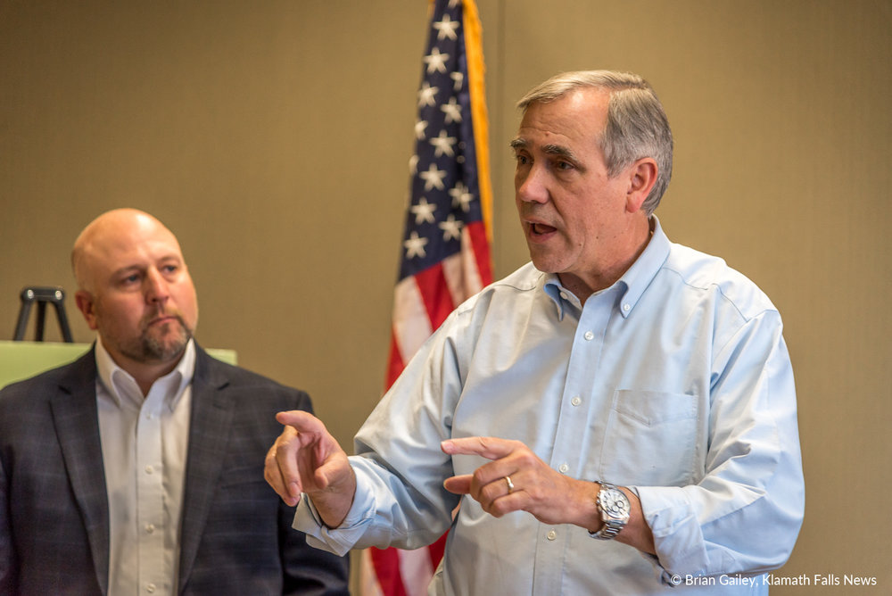 Us Senator Jeff Merkley speaks to the press about the Sucker Recovery Summit. KWUA Executive Director, Scott White watches intently. November 16, 2018 (Brian Gailey)