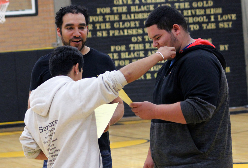 Lost River seniors Bryan Ayala and Reynaldo Espinoza work with Oregon Shakespeare Festival actor Armando McClain during a workshop last week at the high school.