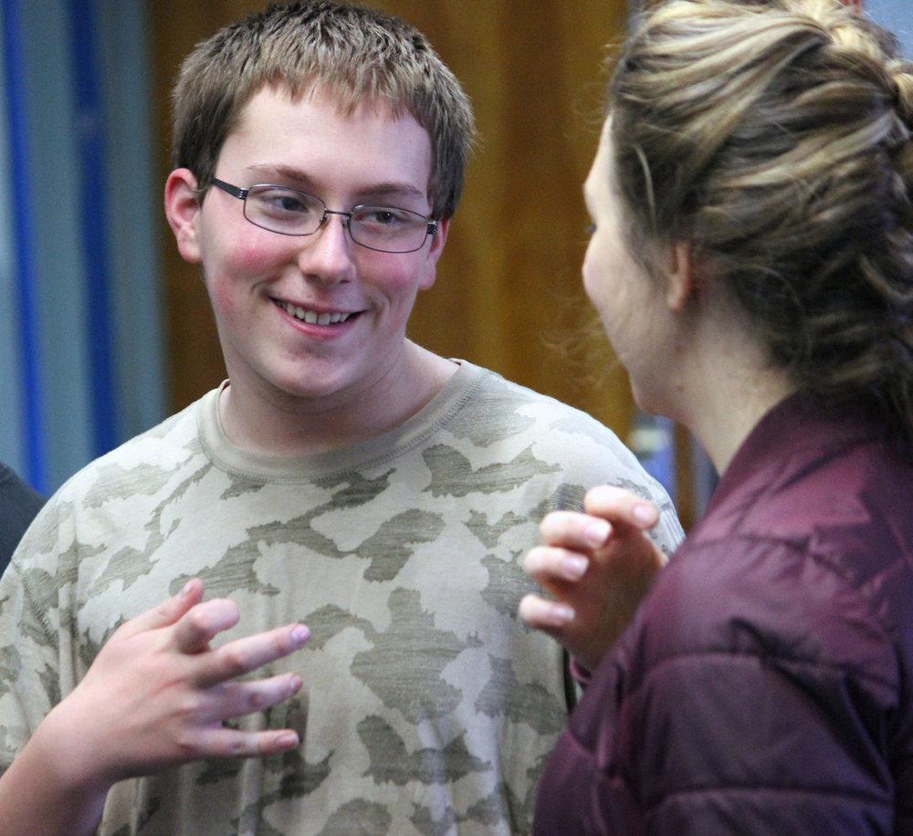 Chiloquin Junior-Senior High School freshman Aden David works with Oregon Shakespeare Festival actor Elizabeth Reese on creating a 10-syllable sentence