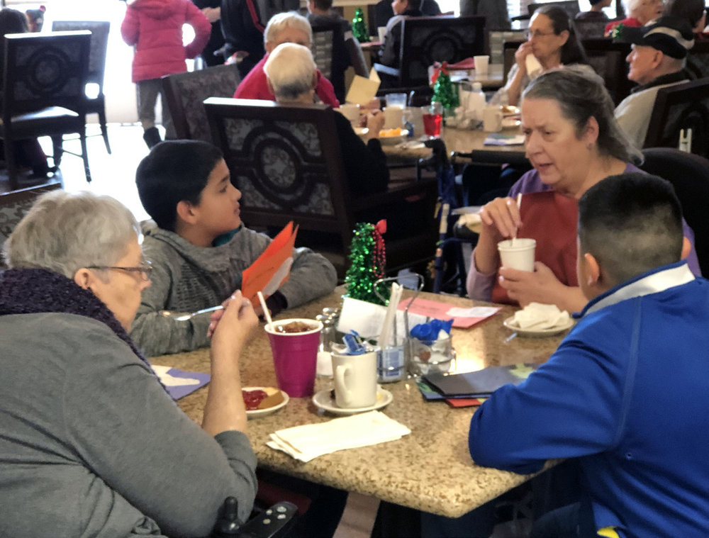 Bonanza students Brian Casillas Juarez and Jeremy Raygoza Cortez visit with residents at Pacifica Senior Living.