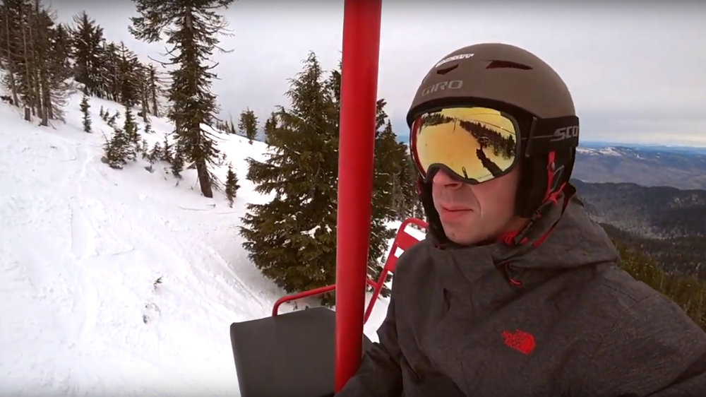 Kenney talks to his audience about Mt Ashland from a chairlift on the mountain. (Image from Mt Ashland video.)