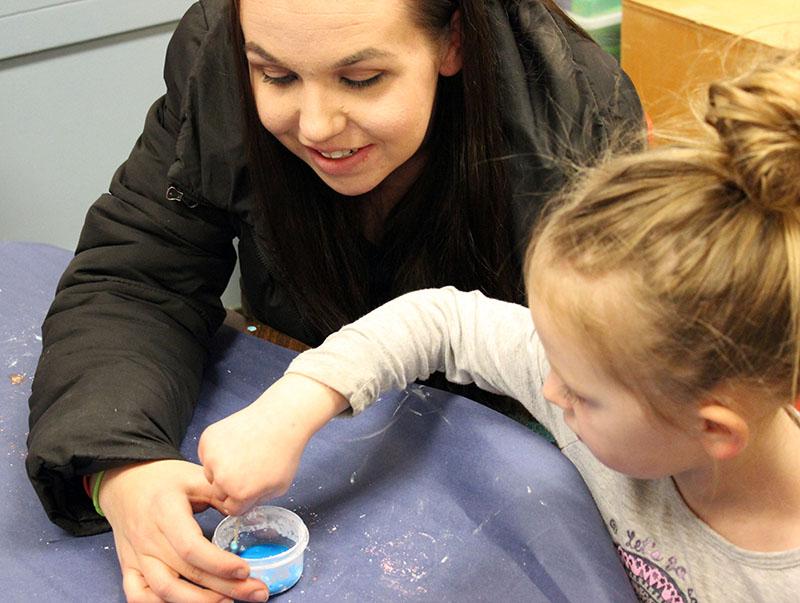 "Emma Beeson, 4, creates ""ooblek"" with her mother, Sevannah Menke."
