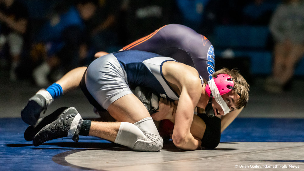 Kyler Pemberton (Mazama) suffers an injury to his nose during his championship match against Gabe Chavez (Hidden Valley) in the 106 weight class. Pemberton overcomes his injury winning over Chavez, 11-3. February 9, 2019 (Image by, Brian Gailey / Klamath Falls News)