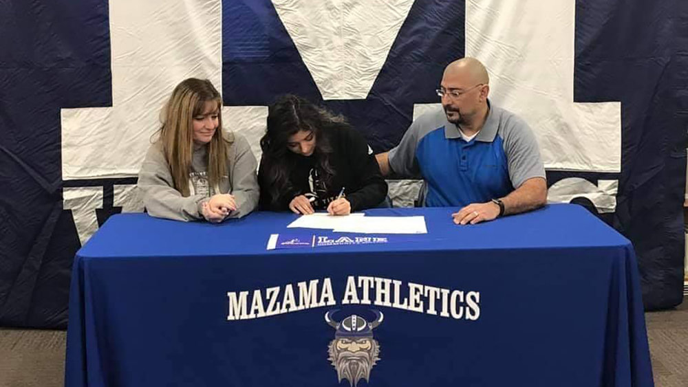 Mazama HIgh School senior Maddy Lease signs of letter of intent to play soccer on a full-tuition scholarship at Lane Community College in Eugene next year. She is flanked by her parents, Joy and Vic Lease.