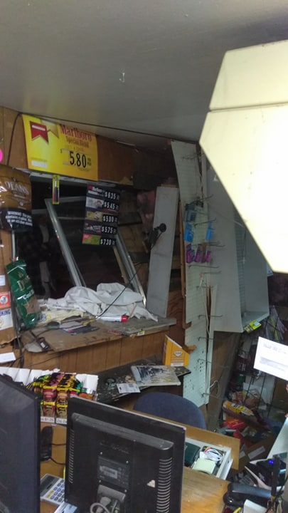 Damage of Dickey's Market following a hit and run crash. Image by Ryan Baker.