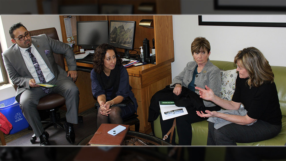 Klamath County School District board members Jill O'Donnell and Denise Kandra talk with state Rep. Diego Hernandez and a staff member during lobbying efforts Tuesday at the state Capitol in Salem.