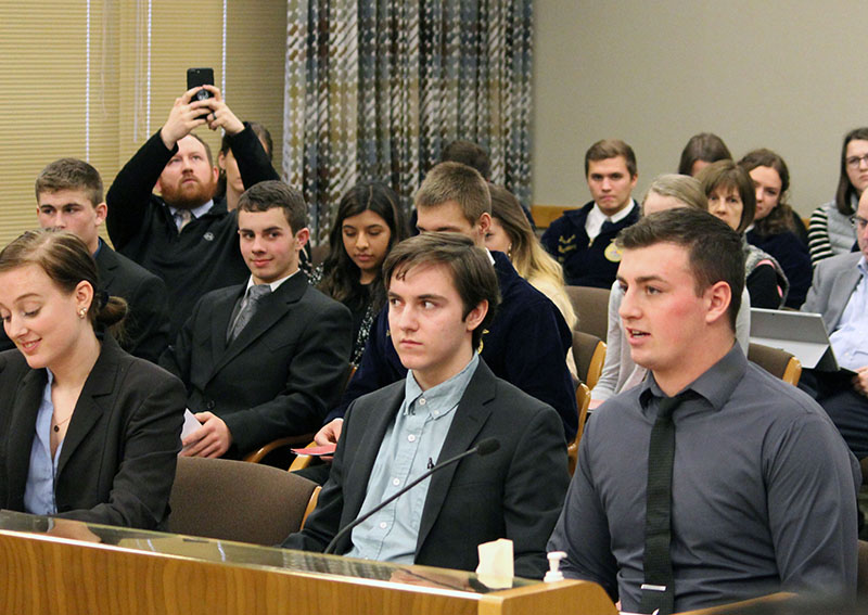 Madison Mefford and Daniel Barstad, both seniors at Gilchrist Junior-Senior High School and Nolan Britton, a senior at Lost River Junior-Senior High School, wait for their turn to testify before the House Committee on Education.