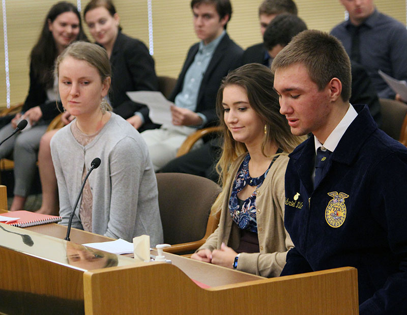 Galen Millen on Bonanza testifies before the House Committee on Education Monday, urging lawmakers to support House Bill 2867. Waiting for their turns to testify are Bella Tenold of Bonanza and Aurora Cerri of Lost River.