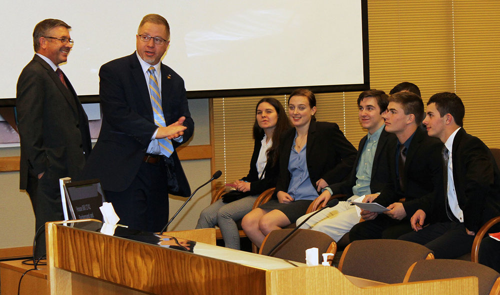 KCSD Superintendent Glen Szymoniak and state Rep. Werner Reschke, R-Klamath Falls, talk to students before their testimony at the House Committee on Education.