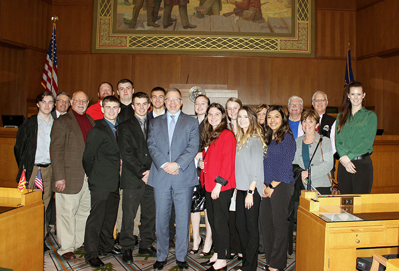 Members of Klamath County School District's Legislative Team, including the district's five school board members, pose with state Rep. Werner Reschke, R-Klamath Falls, on the floor of the House Chambers at the state Capitol in Salem.