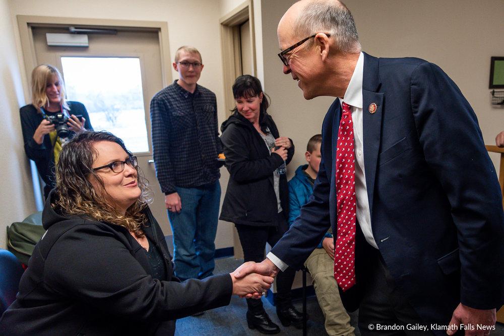 Congressman Walden visiting with a parent at the ribbon cutting of the Klamath County School Based Health Center. March 9, 2019. (Brandon Gailey / Klamath Falls News)
