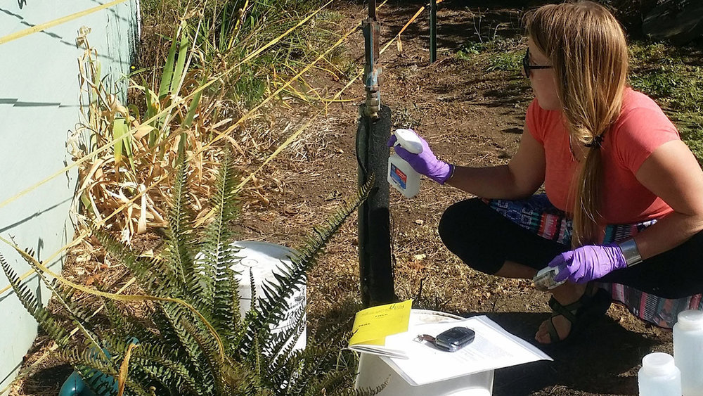 DEQ water quality monitoring specialist Paige Evans samples groundwater from a domestic well in the North Coast Basin in fall 2015.