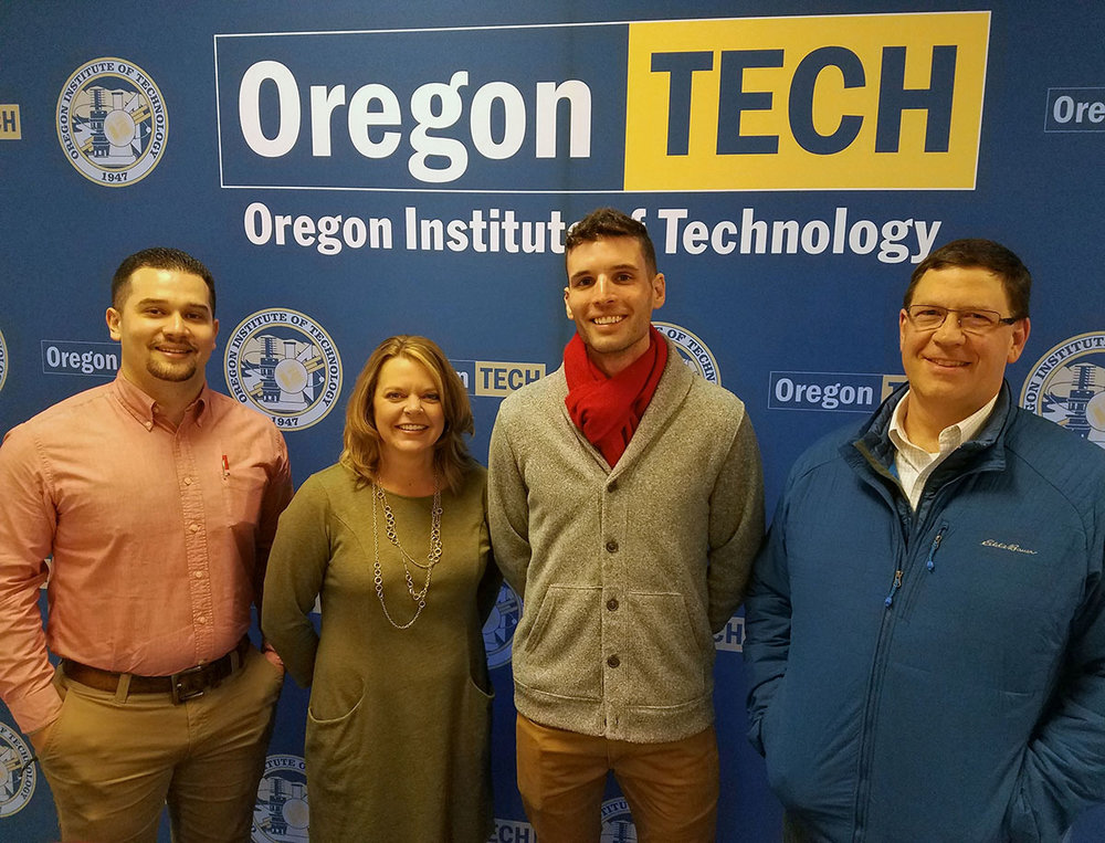 Sergio Cisneros and Benji Henslee of Mazama High School, Luke Ovgard of Henley HIgh School, and Nat Ellis of Klamath Union High School pose for a photo Wednesday after the MOU signing ceremony at Oregon Tech