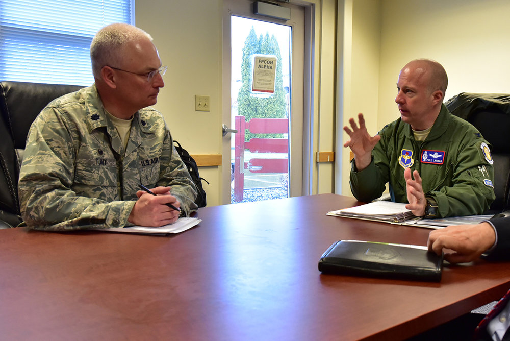 U.S. Air Force Lt. Col. Ed Tuhy, 173rd Medical Group commander, briefs Col. Phillip Layman, Air Force Inspection Agency, and other members of the inspection team on the status of the Medical Group during the 173rd Fighter Wing Unit Effectiveness Inspection capstone event April 5, 2019 at Kingsley Field in Klamath Falls, Oregon. The capstone inspection is culmination of on ongoing virtual inspection on the effectiveness of the unit through four major graded areas—managing resources, leading people, improving the unit, and executing the mission. (U.S. Air National Guard photo by Senior Master Sgt. Jennifer Shirar)