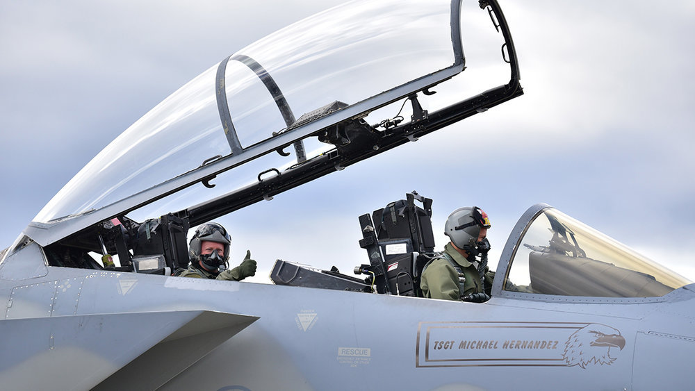 """U.S. Air Force Col. Phillip Layman, Air Force Inspection Agency, gives a """"thumbs up"""" as he prepares for a ride-along in an F-15C with Col. Geoff Jenson, 173d Operations Group Commander, during the 173rd Fighter Wing Unit Effectiveness Inspection capstone event April 6, 2019 at Kingsley Field in Klamath Falls, Oregon. The capstone inspection is culmination of on ongoing virtual inspection on the effectiveness of the unit through four major graded areas—managing resources, leading people, improving the unit, and executing the mission. (U.S. Air National Guard photo by Airman 1st Class Adam Smith)"""