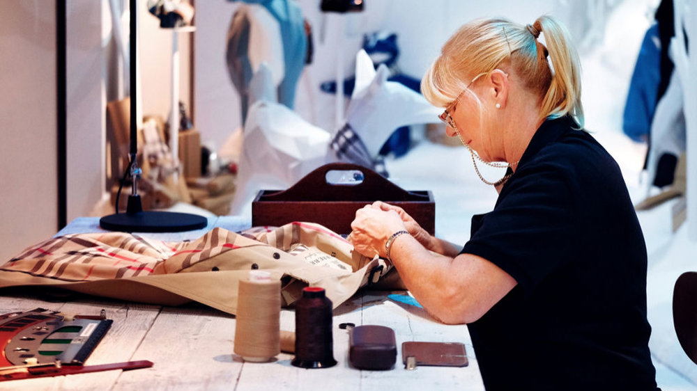 Harrods – Burberry artisan demonstrate the making of the iconic trench coat