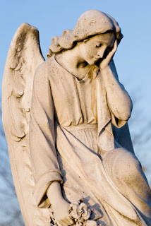 Angel statue, with head in one hand