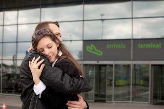 Couple embracing outside airport