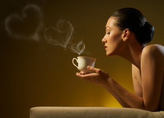 Woman with coffee, love hearts rising from coffee steam