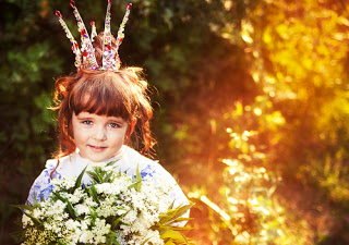 Little girl with crown on her head