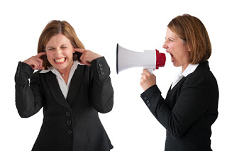 Woman with megaphone telling off other woman