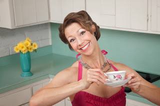 Ridiculously cheerful woman with cup of tea