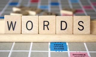 Scrabble letters spelling W-O-R-D-S