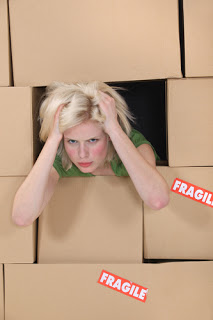 Woman's face among moving boxes