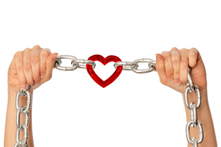 Heart connected by two chains