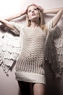 Woman posed with angel wings