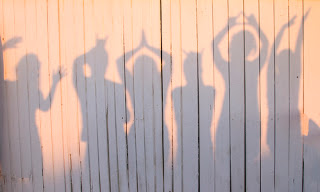 Silhouettes of people having fun and posing