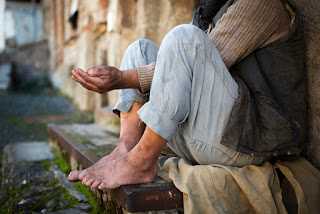 Beggar with outstretched hands