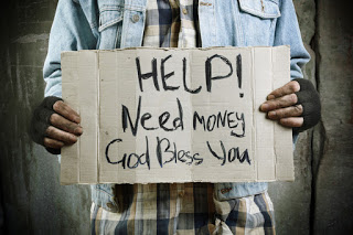 Man with sign: 'Help! Need money, God bless you'