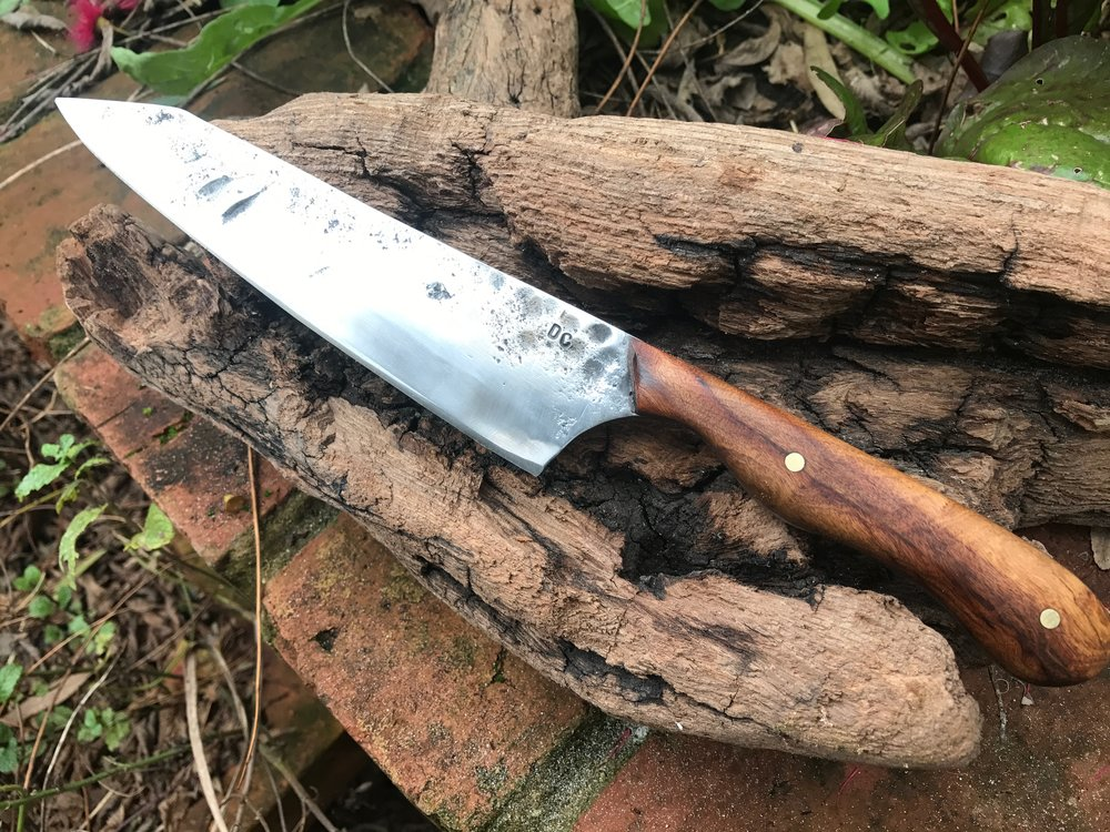 A knife made with my son using Mulga wood we found on a camping trip.