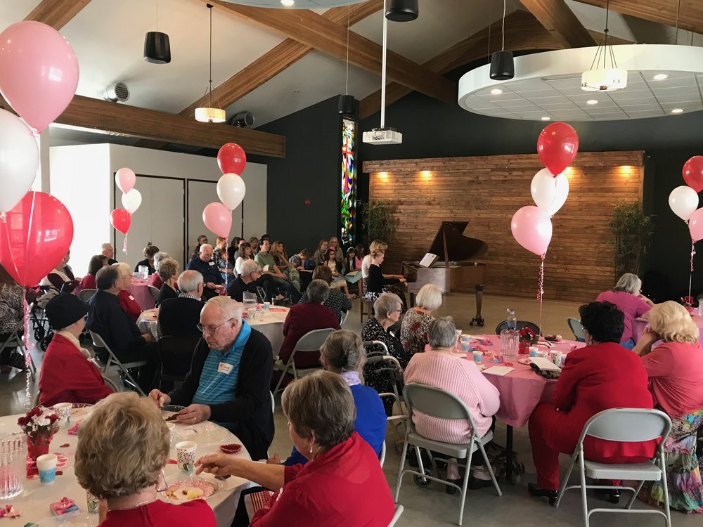 Senior Luncheon underway in the Fellowship Hall (Valentine's theme).