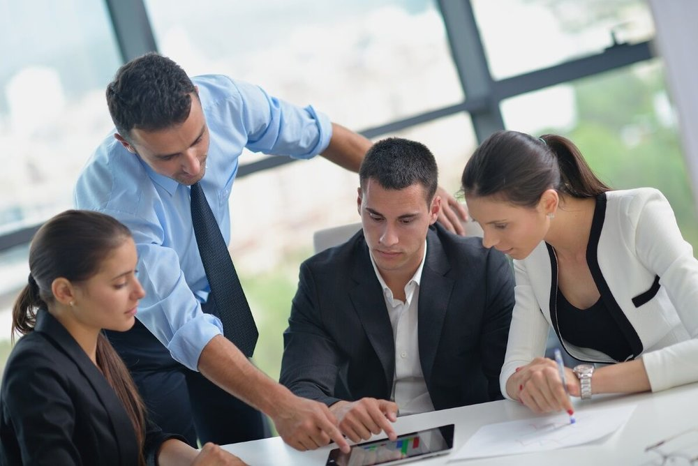 bigstock-Group-of-happy-young-business-50927732_preview.jpg