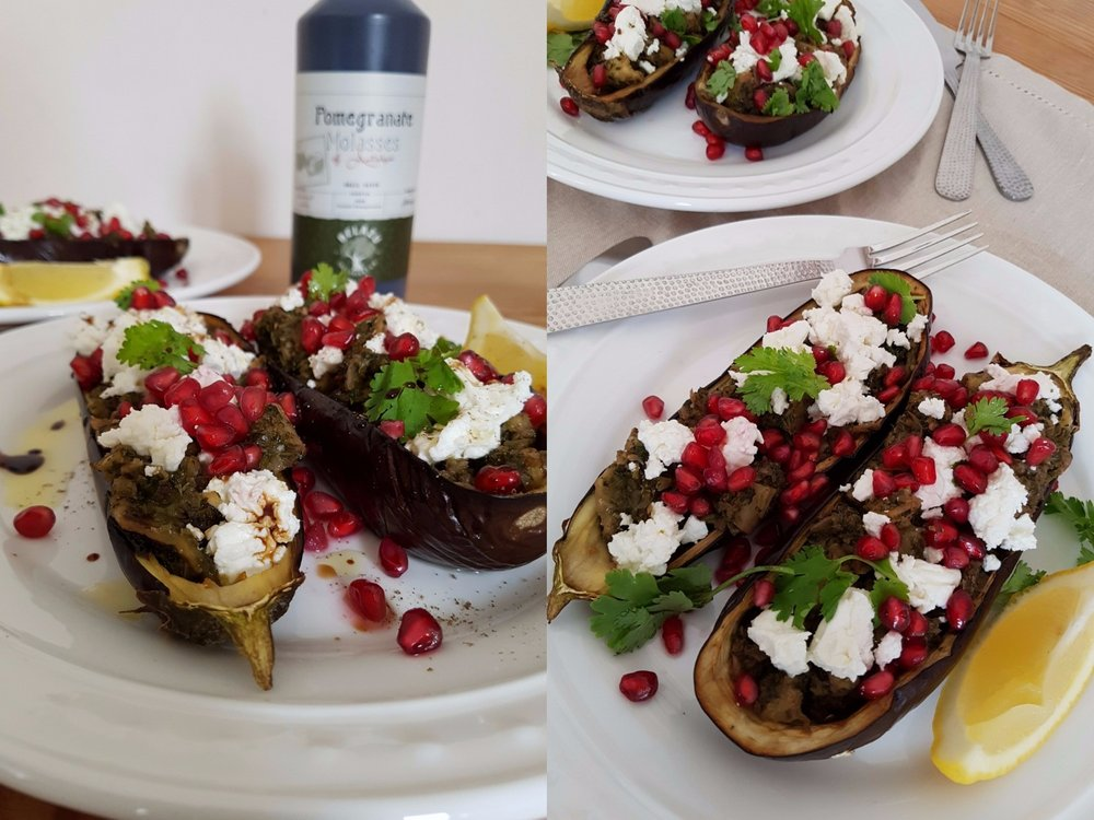 sumac and coriander stuffed aubergines, topped with feta, pomegranate, coriander leaves and pomegranate molasses