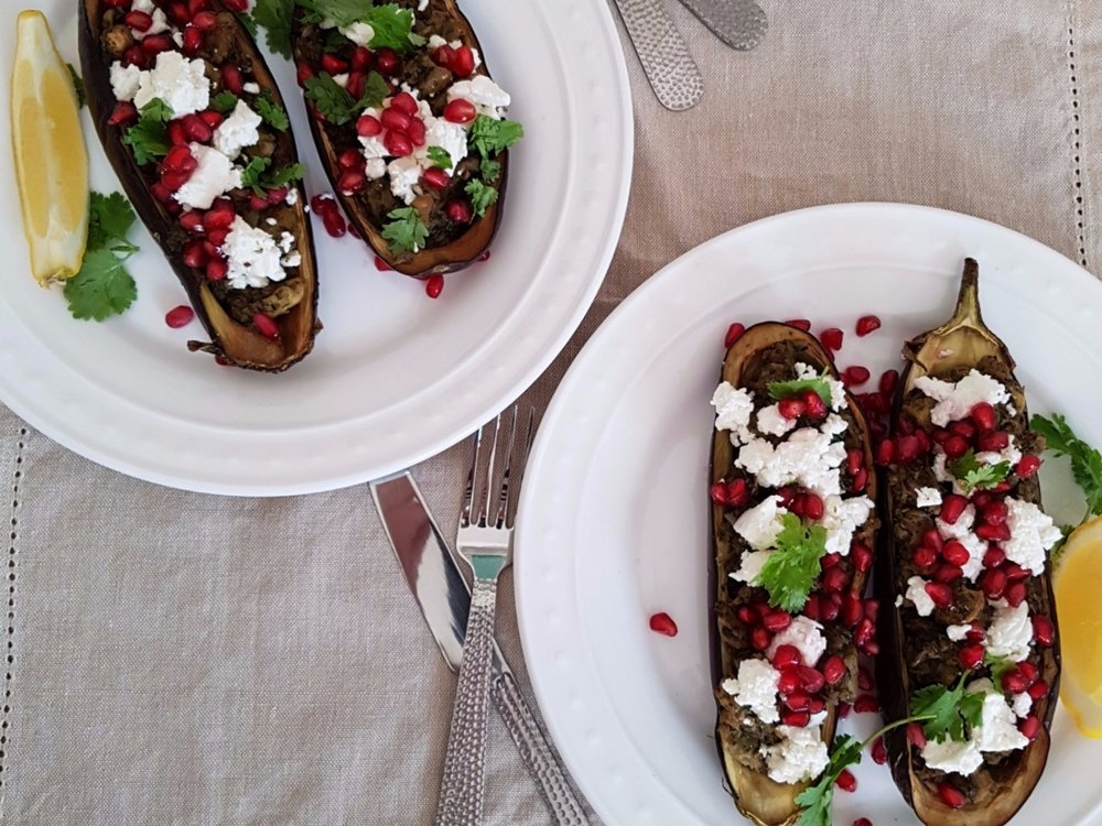STUFFED AUBERGINES WITH SUMAC AND CORIANDER, TOPPED WITH FETA, POMEGRANATE SEEDS AND POMEGRANATE MOLASSES
