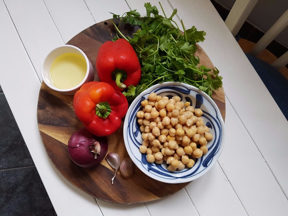 ingredients for red peppers stuffed with fresh coriander, garlic and chcikpeas