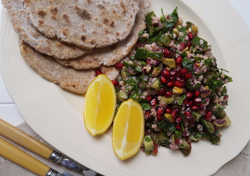 tabbouleh and flatbread with pistachios and pomegranate