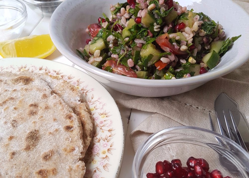 tabbouleh served with spelt flatbread pistachios and pomegranate