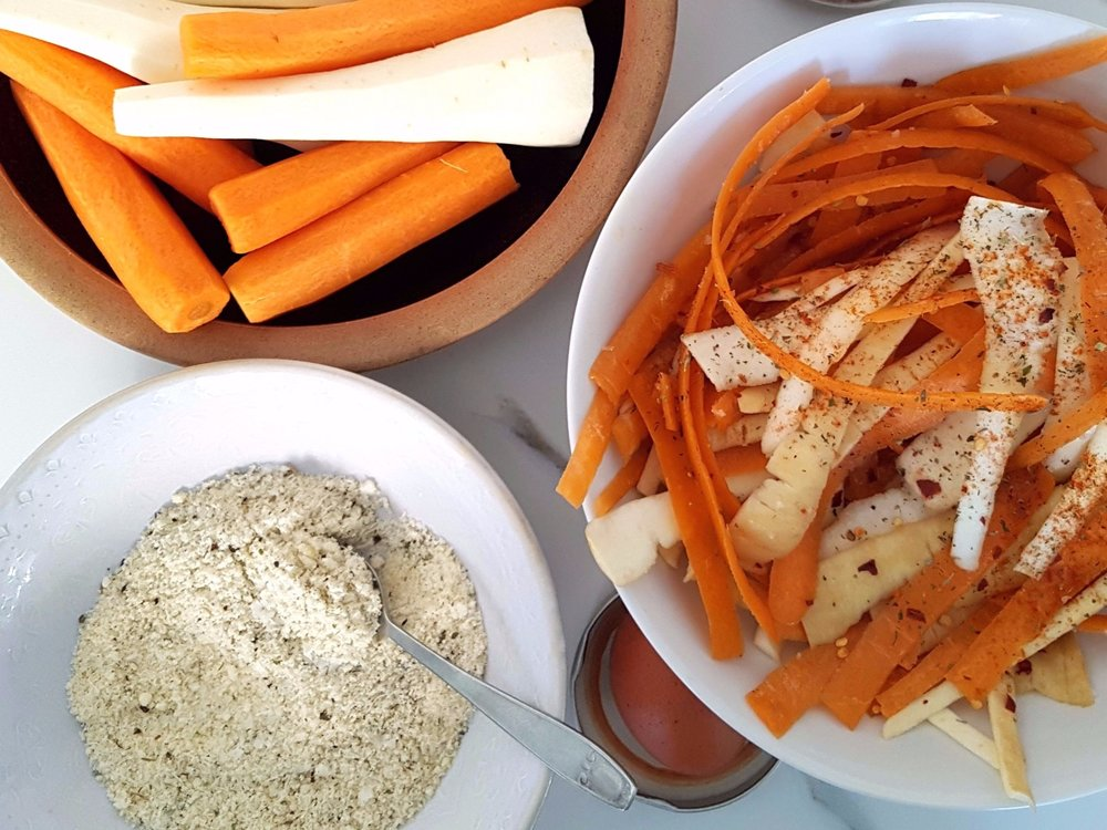 carrots and parsnips with peelings and Parmesan ground almond mix