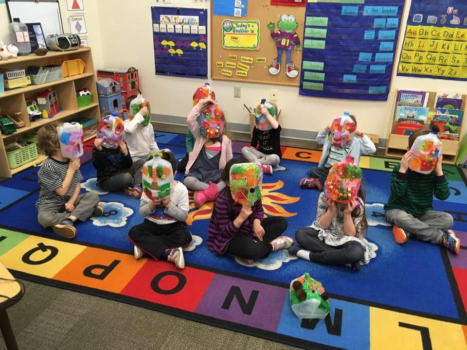 "During the Afternoon Adventures classes' ""Planet Protectors"" unit, students make masks out of recycled water jugs."