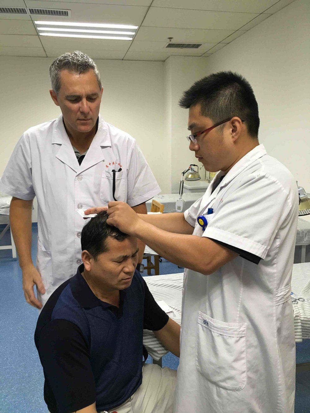 Dr. Tony Willcox completing his 2nd Doctorate in Acupuncture studying at Anhui University of Traditional Chinese Medicine. Pictured here learning Zhu's Scalp acupuncture with Dr. Pan in Hefei, China.